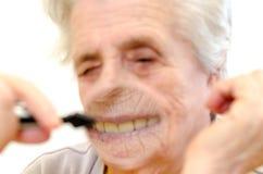 Счастливая старая gray-haired женщина стоковые изображения