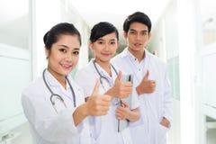 Счастливые азиатские доктора стоковое фото rf