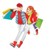 Счастливые любовники идя под деревья вишневого цвета, нося несколько хозяйственных сумок Стоковые Изображения