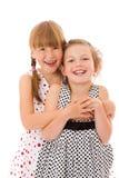 счастливые маленькие сестры стоковое изображение