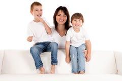 Счастливые мать и дети стоковая фотография rf