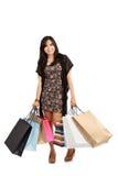 Счастливые мешки удерживания девушки покупкы Стоковая Фотография RF