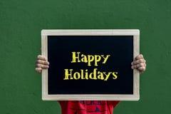 Счастливые праздники написанные классн классному детям стоковая фотография rf