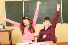 счастливые ребенокы школьного возраста Стоковые Изображения RF