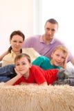 Счастливые родители с их дет Стоковые Фотографии RF