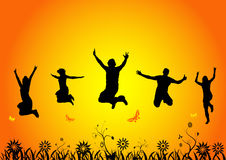 счастливые скача люди Стоковые Фото
