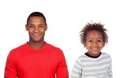 Счастливый африканский ребенок и его отец стоковые изображения