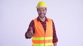 Счастливый бородатый персидский рабочий-строитель человека давая рукопожатие акции видеоматериалы