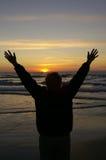 счастливый заход солнца Стоковые Изображения