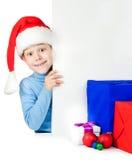 Счастливый малыш с много подарками Кристмас Стоковые Изображения