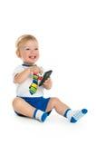 Счастливый младенец с сотовым телефоном Стоковое Изображение