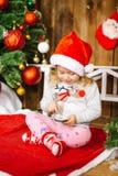 Счастливый мобильный телефон игры ребёнка santa Стоковое Фото