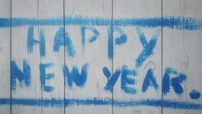 Счастливый Новый Год на деревянных досках написанных в голубой краске Стоковая Фотография RF