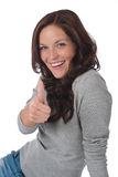 счастливый показывать thumbs вверх по детенышам женщины Стоковое фото RF