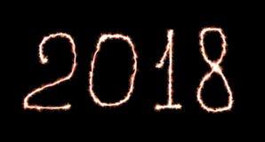 Счастливый помечать буквами Нового Года 2018 написанный с огнем Стоковое Изображение RF