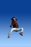 счастливый скача человек стоковое фото rf