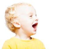 Счастливый смеясь над ребенок Стоковые Фото