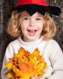 счастливый смеяться над малыша Стоковые Изображения