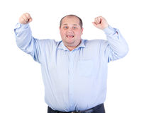 Счастливый тучный человек в голубой рубашке Стоковое фото RF