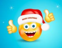 Счастливый усмехаться вокруг стороны нося красную шляпу Санта Клауса с помечать буквами с Рождеством Христовым показывая большие  иллюстрация штока