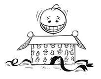 Счастливый усмехаясь человек смотря, что внутри раскрыть подарочную коробку рождества Стоковое фото RF