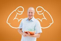 Счастливый человек студента при график кулаков стоя против оранжевой предпосылки Стоковая Фотография RF