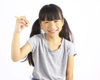 Счастливая девушка держа карандаш Стоковые Изображения RF