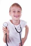 Счастливая девушка играя доктора Стоковые Фото