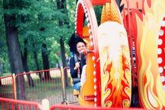 Счастливая девушка на carousel Стоковые Фотографии RF