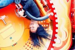 Счастливая девушка на carousel Стоковые Изображения RF