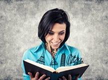Девушка с книгой Стоковые Изображения RF