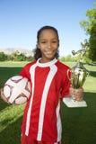 Счастливая девушка с трофеем Стоковая Фотография