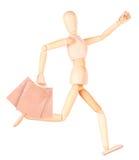 Счастливая деревянная кукла с хозяйственными сумками Стоковое Изображение