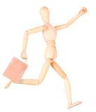 Счастливая деревянная кукла с хозяйственными сумками Стоковое фото RF