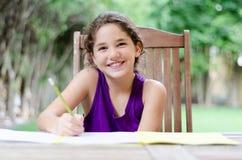 Счастливая делая домашняя работа Стоковое Изображение