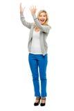 Счастливая женщина держа голубые джинсы пустого космоса изолированный на белом bac Стоковое Фото