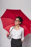 Счастливая женщина с зонтиком стоковое изображение rf