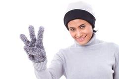 Счастливая женщина указывая вверх по 3 пальцам Стоковое фото RF
