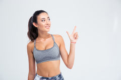 Счастливая заботливая девушка указывая палец вверх Стоковые Изображения