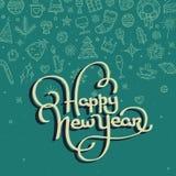 Счастливая литерность Нового Года на зеленой предпосылке Стоковое Фото