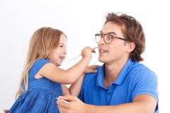 Счастливая картина дочери с отцом Стоковое Фото