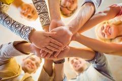 Счастливая команда дела соединяя их руки Стоковые Изображения RF