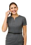 Счастливая коммерсантка говоря на умном телефоне Стоковое фото RF