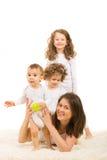 Счастливая мама с 3 детьми Стоковое фото RF