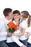 Счастливая мать расцелованная ее семьей стоковые фото