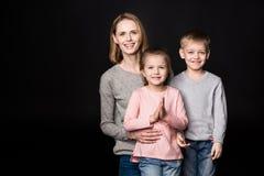 Счастливая мать с детьми Стоковая Фотография RF
