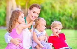 Счастливая мать с младенцами Стоковое Фото
