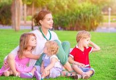 Счастливая мать с младенцами Стоковая Фотография RF