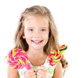Счастливая маленькая девочка при изолированный леденец на палочке Стоковое Изображение