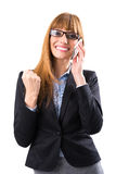 Счастливая молодая бизнес-леди с телефоном стоковые изображения rf